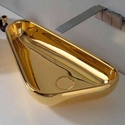 Moderne bordplade i guld keramik lavet i Italien Sofia